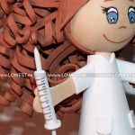 muñeca enfermera jeringuilla